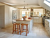 THE COACH HOUSE,SURREY:COUNTRY KITCHEN BY PLAIN ENGLISH, STOOLS FROM POTTERY BARN AND ISLAND.NEUTRAL DECOR,LIGHT,AIRY, TUMBLED MARBLE FLOOR, BELFAST/BUTLER SINK