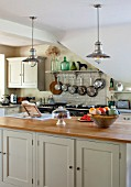 THE COACH HOUSE,SURREY: COUNTRY KITCHEN BY PLAIN ENGLISH, NEUTRAL DECOR. ISLAND WITH BRUSHED STEEL PENDANT LIGHTS, POTS AND PANS HANGING ABOVE AGA WITH SHELF