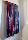 THE COACH HOUSE,SURREY: DRESSING ROOM WITH WOODEN TIE RACK