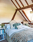 THE COACH HOUSE,SURREY: POLLYS BEDROOM WITH BLANKET FROM NEPTUNE, CUSHIONS BY HUDSON HOMES & INTERIORS. NEUTRAL DECOR, OAK BEAMS, ORIGINAL FEATURES