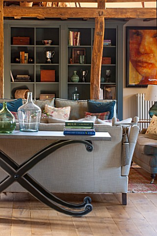 THE_COACH_HOUSESURREYFAMILY_ROOM_WITH_SOFAS_CONSOLE_TABLE_BY_ANDREW_MARTIN_WOODEN_FLOOR_PORTRAIT_BY_