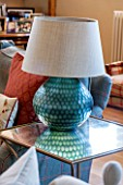 THE COACH HOUSE,SURREY: FAMILY ROOM WITH DETAIL OF LAMP BY OKA OIN GLASS SIDE TABLE BY JULIAN CHICHESTER