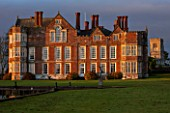BURTON AGNES HALL, EAST YORKSHIRE: CHRISTMAS - THE ELIZABETHAN HALL AT SUNRISE, DAWN, MORNING LIGHT, CLASSIC, ENGLISH, GARDEN, FORMAL