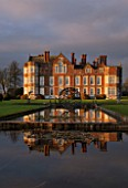 BURTON AGNES HALL, EAST YORKSHIRE: CHRISTMAS - ELIZABETHAN HALL, SUNRISE, DAWN, MORNING LIGHT, CLASSIC, ENGLISH, GARDEN, FORMAL, POND, POOL, EAST LAWN, ORB FOUNTAIN BY GILES RAYNER