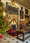 BURTON AGNES HALL, EAST YORKSHIRE: CHRISTMAS  - GREAT HALL, CHRISTMAS TREE, BOUGHS AND BRANCHES FROM THE ESTATE. ORNAMENT