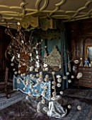 BURTON AGNES HALL, EAST YORKSHIRE: CHRISTMAS - THE KINGS BEDROOM DECORATED FOR CHRISTMAS WITH AN OAK BRANCH, PAPER BOOK BALL POM-POM DECORATIONS. ORNAMENT