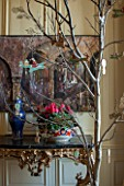 BURTON AGNES HALL, EAST YORKSHIRE: CHRISTMAS - GARDEN GALLERY - WOODEN AEROPLANE AND SLEIGH CUT OUT DECORATIONS IN OAK BRANCH TREE, CERAMIC BOWL PLANTED WITH CYCLAMEN