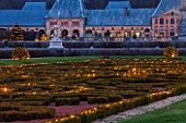 VAUX LE VICOMTE, FRANCE: THE PARTERRE AT NIGHT AT CHRISTMAS DECORATED WITH FAIRY LIGHTS. ILLUMINATION, ILLUMINATED, DECRATION, DUSK, PARK, GARDEN, WINTER, CHRISTMAS TREE, TREES