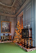 VAUX LE VICOMTE, FRANCE: THE KINGS FORMER STUDY AT CHRISTMAS. GREY PANELLED WALLS AND CHRISTMAS TREE.