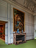 VAUX LE VICOMTE, FRANCE: THE KINGS FORMER STUDY AT CHRISTMAS. GREY PANELLED WALLS AND MARBLE FIREPLACE
