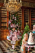 VAUX LE VICOMTE, FRANCE: THE KINGS ANTICHAMBER - LOUIS XIV MAHOGANY BOOKSHELVES. SWEET AND SUGAR DECORATIONS REPRESENT THE GERMAN FAIRTY TALE HANSEL AND GRETEL