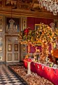 VAUX LE VICOMTE, FRANCE: THE HERCULES ANTECHAMBER AT CHRISTMAS. CEILINGS AND WALL PANELS DECORATED BY LE BRUN IN THE THEME OF HERCULES. DECORATIONS ARE SCENES FROM PETER PAN