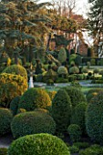 BRODSWORTH HALL, YORKSHIRE: DAWN. WINTER, JANUARY, TOPIARY EVERGREEN, BORDER, FORMAL, GARDEN, COUNTRY, CLIPPED, CEDAR OF LEBANON, TREE, FOUNTAIN