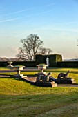 BRODSWORTH HALL, YORKSHIRE: DAWN. WINTER, JANUARY, VIEW ACROSS LAWN TO YEW HEDGE. STATUES, URNS, STONE, ORNAMENT