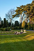 BRODSWORTH HALL, YORKSHIRE: VIEW ACROSS LAWN TO BORDER OF TOPIARY. VICTORIAN, COUNTRY, GARDEN, FORMAL, STATUES, STATUARY