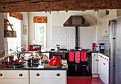 THE FREETH, HEREFORDSHIRE: KITCHEN IN RED, WHITE AND BLACK. AGA, RED TOASTER
