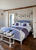 THE FREETH, HEREFORDSHIRE: LILAC BEDROOM - BED, CUSHIONS, BUTTERFLY PRINTS, THROW, PRESENTS, CHRISTMAS