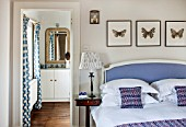 THE FREETH, HEREFORDSHIRE: LILAC BEDROOM - BED, CUSHIONS, BUTTERFLY PRINTS, THROW, PRESENTS, CHRISTMAS, EN SUITE BATHROOM, BEDSIDE LAMP