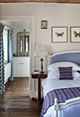 THE FREETH, HEREFORDSHIRE: LILAC BEDROOM - BED, CUSHIONS, BUTTERFLY PRINTS, THROW, PRESENTS, CHRISTMAS, EN SUITE BATHROOM, BEDSIDE LAMP, WOODEN FLOOR