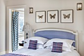 THE FREETH, HEREFORDSHIRE: LILAC BEDROOM - BED, CUSHIONS, BUTTERFLY PRINTS, THROW, PRESENTS, CHRISTMAS, BEDSIDE LAMP