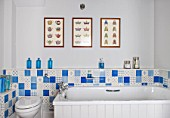 THE FREETH, HEREFORDSHIRE: TURQUOISE AND WHITE BATHROOM. BATH, TILES, TOILET, PRINTS