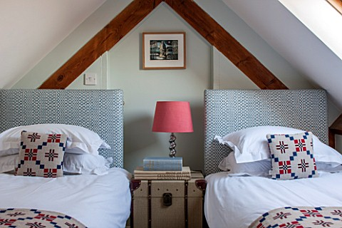 THE_FREETH_HEREFORDSHIRE_ATTIC_TWIN_ROOM__BEDS_LAMP_FABRIC_CHEST_BEDROOM_CUSHIONS_BEDHEADS