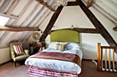THE FREETH, HEREFORDSHIRE: DOUBLE BEDROOM - BED, HEADBOARD IN GREEN LINEN, WICKER CHAIR
