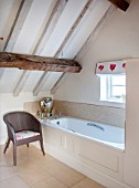 THE FREETH, HEREFORDSHIRE: DOUBLE BEDROOM - BATHROOM, WHITE, TULIP PRINT BLIND, WICKER CHAIR, BATH