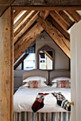 THE FREETH, HEREFORDSHIRE: BEDROOM WITH EVES, WOODEN BEAMS, STOCKINGS, CHRISTMAS, CUSHIONS, BED