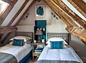 THE FREETH, HEREFORDSHIRE: TWIN JADE BEDROOM. BEDS, JADE WALL PAINT, HEADBOARD, CUSHIONS, THROW, BEDSIDE TABLE, LEAF WALL PRINT