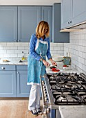 LONDON HOUSE DESIGNED BY JULIE SIMONSEN. JULIE SIMONSEN IN HER BLUE KITCHEN.