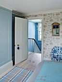 LONDON HOUSE DESIGNED BY JULIE SIMONSEN. DOOR SHOWING ENTRANCE TO BLUE BEDROOM WITH DASH & ALBERT CHECKED RUG.