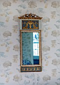 LONDON HOUSE DESIGNED BY JULIE SIMONSEN.  BLUE BEDROOM. GUSTAVIAN MIRROR IN GRECIAN STYLE BOUGHT FROM COUSIN. WALLPAPER BY COLEFAX & FOWLER