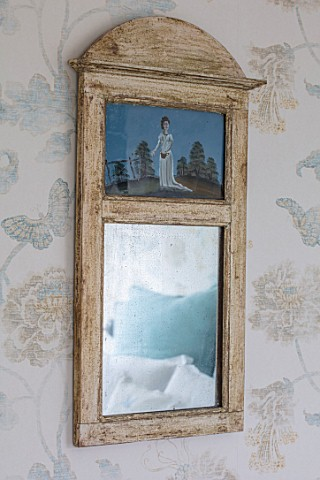 LONDON_HOUSE_DESIGNED_BY_JULIE_SIMONSEN_ANTIQUE_PAINTED_MIRROR_IN_BLUE_BEDROOM