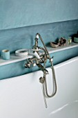 LONDON HOUSE DESIGNED BY JULIE SIMONSEN. BLUE BATHROOM. DETAIL OF VINTAGE STYLE TAPS AND SHOWER ATTACHMENT IN BATH