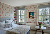 LONDON HOUSE DESIGNED BY JULIE SIMONSEN. PINK BEDROOM SHOWING OSBORNE & LITTLE WALLPAPER, GREY LINEN BEDHEAD AND ZARA HOME BEDLINEN.