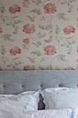 LONDON HOUSE DESIGNED BY JULIE SIMONSEN. BEDROOM WITH FLORAL OSBORNE & LITTLE WALLPAPER WITH GREY LINEN BESPOKE HEADBOARD