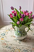 LONDON HOUSE DESIGNED BY JULIE SIMONSEN. TULIPS IN JUG ON PAINTED ANTIQUE TABLE FROM THE BALTICS