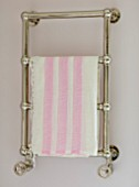 LONDON HOUSE DESIGNED BY JULIE SIMONSEN. PINK BATHROOM. CHROME TOWEL RAIL ON WALL WITH PINK AND WHITE STRIPED TOWEL