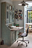 LONDON HOUSE DESIGNED BY JULIE SIMONSEN. GUSTAVIAN DRESSER USED AS BUREAU IN HOME OFFICE