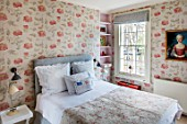LONDON HOUSE DESIGNED BY JULIE SIMONSEN. GUEST BEDROOM WITH PAINTING OF YOUNG GIRL FOUND AT PARISIAN ANTIQUES DEALER. JULIE DECORATED THE WHOLE ROOM AROUND HER. QUILTED ANTIQUE WELSH COVERLET.