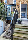LONDON HOUSE DESIGNED BY JULIE SIMONSEN. STEPS FROM KITCHEN LEADING DOWN INTO GARDEN