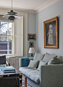 LONDON HOUSE DESIGNED BY JULIE SIMONSEN. LIVING ROOM WITH INHERITED DUTCH PAINTING THAT PROVIDED INSPIRATION FOR COLOUR SCHEME. SOFA BY CARAVANE AND VINTAGE STUDDED LEATHER TRUNK USED AS COFFEE TABLE.