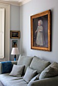 LONDON HOUSE DESIGNED BY JULIE SIMONSEN. LIVING ROOM WITH INHERITED DUTCH PAINTING THAT PROVIDED INSPIRATION FOR COLOUR SCHEME. SOFA BY CARAVANE