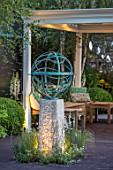 DAVID HARBER SUNDIALS:CHELSEA 2017.BRONZE ARMILLERY SPHERE SCULPTURE WITH WOODEN PAVILLION/PERGOLA AND SEATING AREA.RELAX,CONTEMPORARY,MODERN,NIGHT,EVENING,LIGHTING,RELAX,ART,CRAFT
