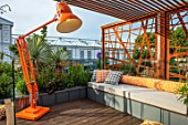 CHELSEA FLOWER SHOW 2017: CITY LIVING GARDEN DESIGNED BY KATE GOULD. MODERN, CONTEMPORARY, ANGLEPOISE LAMP, LIGHTING, ORANGE, SEAT, SEATING, DECK, DECKING, CUSHIONS, RELAXING
