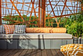CHELSEA FLOWER SHOW 2017: CITY LIVING GARDEN DESIGNED BY KATE GOULD. MODERN, CONTEMPORARY, METAL, SCREEN, SCREENING, ORANGE, SEAT, SEATING, DECK, DECKING, CUSHIONS, RELAXING