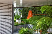 CHELSEA FLOWER SHOW 2017: CITY LIVING GARDEN DESIGNED BY KATE GOULD. MODERN, CONTEMPORARY, FOLIAGE, LIVING, WALL, GREEN, TREE FERN, LAMP, ANGLEPOISE, ORANGE, BASEMENT