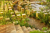 CHELSEA FLOWER SHOW 2017: THE M & G GARDEN DESIGNED BY JAMES BASSON. ROCK, STONE, QUARRY, MALTA, LIMESTONE BLOCKS, MALTESE FLORA, MEDITERRANEAN
