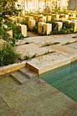 CHELSEA FLOWER SHOW 2017: THE M & G GARDEN DESIGNED BY JAMES BASSON. ROCK, STONE, QUARRY, MALTA, LIMESTONE BLOCKS, MALTESE FLORA, MEDITERRANEAN, POOL, POND